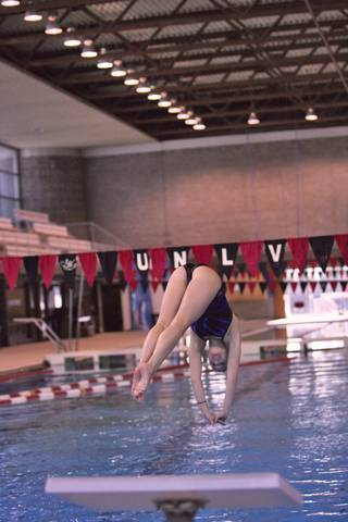 Jordyn Lauten, a Coronado graduate who recently transferred to UNLV, dives during practice at UNLV's Buchanan Natatorium.