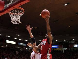 Wink Adams lays it in over a New Mexico defender Saturday as UNLV took on the New Mexico Lobos Saturday in Albuquerque New Mexico at the Pit. The Lobos defeated the Rebels 73-69 in overtime; it was the second straight game UNLV has lost in overtime.