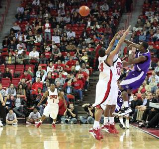 The UNLV defense presses TCU as UNLV took on the TCU Horned Frogs Tuesday at the Thomas & Mack Center in Las Vegas.