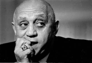 Former UNLV Men's Basketball coach Jerry Tarkanian bites his nails during a press conference.