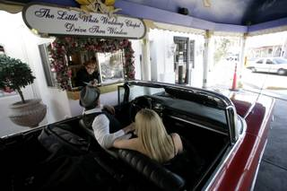 Little White Wedding Chapel on the north end of the Las Vegas Strip offers five different chapels to be married in including a drive thru window. Kurt Langer from New Zealand and Karen Kerr came to Las Vegas and rented a car just to be married at the drive thru.