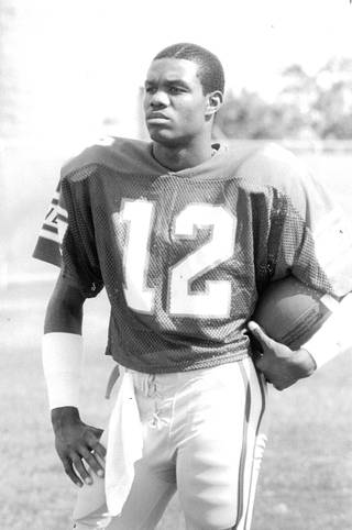 NFL great Randall Cunningham during his days with UNLV. Cunningham threw for over 8,000 passing yards an averaged 45.6 yards per punt for the Rebels, both UNLV records.