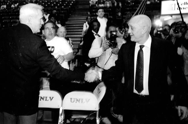 Jerry Tarkanian shakes hands during Tark's final game as coach ...
