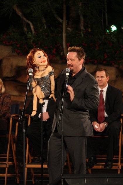 Terry Fator and one of his cast of thousands at the premiere of The Mirage volcano.
