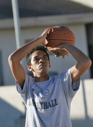 Liberty Baptist Academy junior Mikel Simmons Jr. lines up a shot during practice.