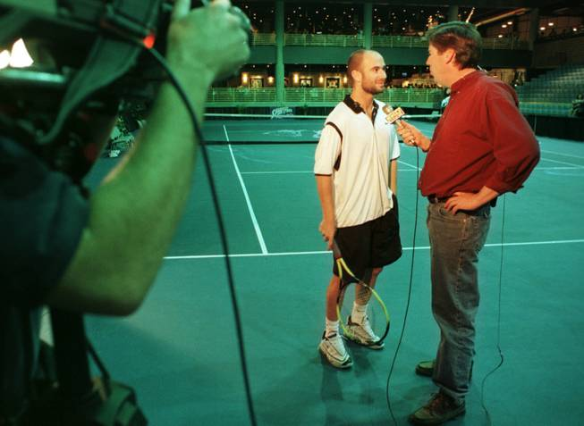 Ron Futrell interviews Andre Agassi during Futrell's days as a sports reporter at KTNV Channel 13.