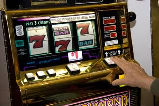 Gene Gabaldon puts a few dollars on a Megabucks machine at the South Point Casino on Friday, Feb. 13, 2009.