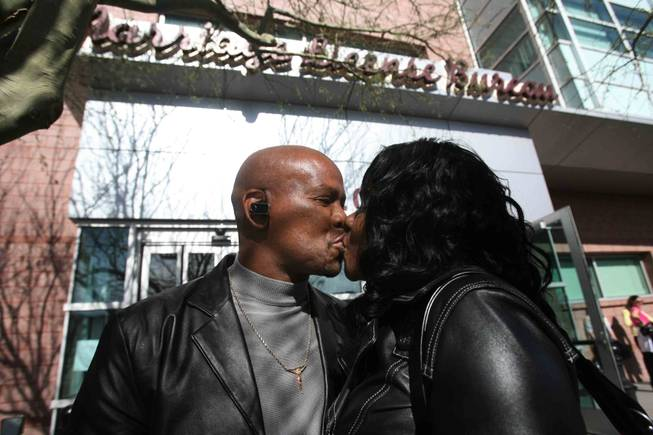 California residents Hollie McLeod, left, and Lydia Davis kiss after obtaining their marriage license at the Marriage License Bureau in downtown Las Vegas on Friday, Feb. 13, 2009.