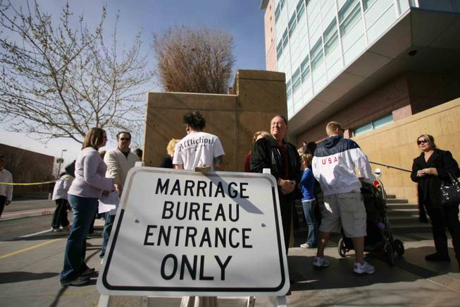 Couples line up outside the Marriage License Bureau at the Regional Justice Center in downtown Las Vegas on  the day before  Valentine's Day, 2009.