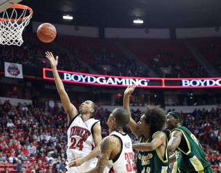 Tre'Von Willis blows past the Colorado State defense Saturday night at the Thomas & Mack Center. The Rebels defeated Colorado State 89-70 for their second straight win.