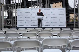 Larry Ruvo does a sound check just before a press conference announcing the Lou Ruvo Brain Institute's partnership with the Cleveland Clinic, at the brain institute in Las Vegas on Tuesday.