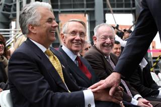 Sen. John Ensign, from left, Sen. Harry Reid and Mayor Oscar Goodman laugh as former Nevada Governor Kenny Guinn passes to take the stage in February to speak at a press conference announcing the Lou Ruvo Brain Institute's partnership with the Cleveland Clinic at the brain institute in Las Vegas.