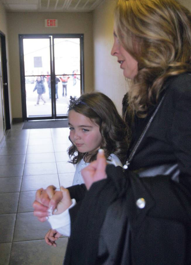 Green Valley Christian Academy student Nadia Voelkening and her mother, Michele, make their way through the halls of Mountain View Christian School to the classroom where Nadia will compete in the Association of Christian Schools speech competition.