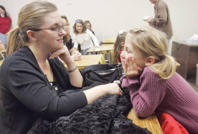 Calvary Chapel's Mary Cullen talks to her daughter, Summer, before she competes in the Association of Christian Schools speech competition on Friday at Mountain View Christian School.