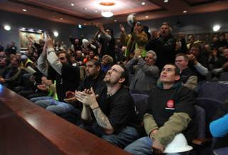 Members of Laborers Union Local 872 applaud as the Las Vegas City Council unanimously authorized a
