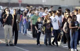 People wait in line Thursday, February 18, 2010 to get tickets to the President Barack Obama's Friday town hall meeting at Green Valley High School in Henderson.
