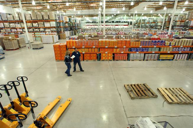 Marketing manager Bobby Alexander, right, talks with Kathy Darling inside the new Costco Business Center on Martin Luther King Boulevard on Feb. 11, 2009.