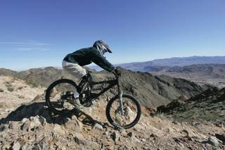 A rider takes part takes part in the Super D race during the Mob 'N Mojave downhill cycling competition at Bootleg Canyon in Boulder City on Saturday.