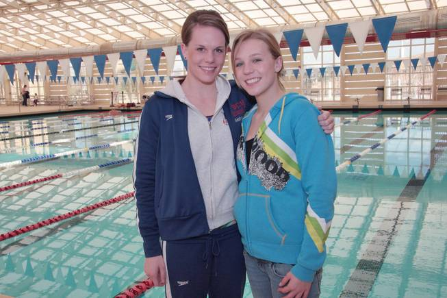 Green Valley High School senior swimmers Addie, right and Carlee Oswald pose for a photo.