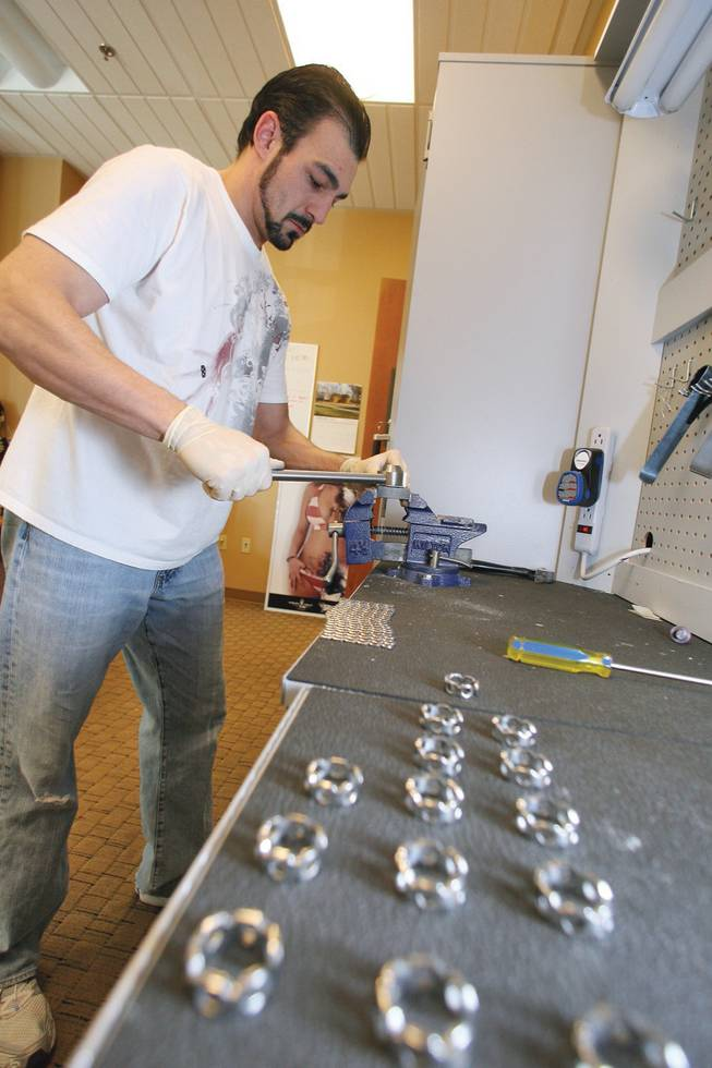 Jewelry Design Specialist Brent Bardellini forms a batch of Recon Rings from the Skeletal Metal Surgical jewelry line at their Henderson office.