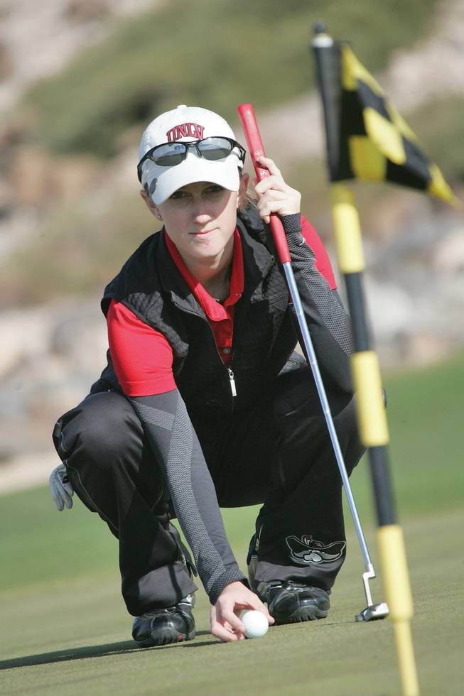UNLV freshman Bethany Glassford lines up a putt during a practice round at the Rio Secco Golf Club.