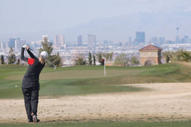UNLV freshman Bethany Glassford drives her ball during a practice at the Rio Secco Golf Club.
