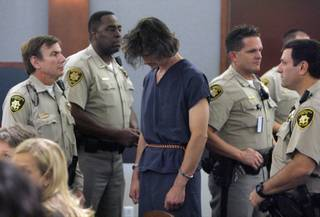 Chester Arthur Stiles, center, was arraigned Oct. 17, 2007, at the Clark County Regional Justice Center in Las Vegas. He is charged with videotaping himself molesting a 2-year-old girl.