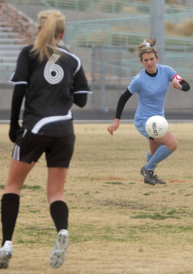 Julie Owens, a midfielder on the Centennial girls' soccer team, runs after the ball during a game against Palo Verde on Feb. 9 at Centennial High School. Owens recently signed a letter of intent to play soccer at UNLV next fall.