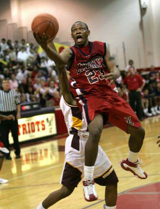 Liberty's Kenneth Peters (23) goes for a basket against Eldorado during the Sunrise Regional Finals at Liberty Friday.