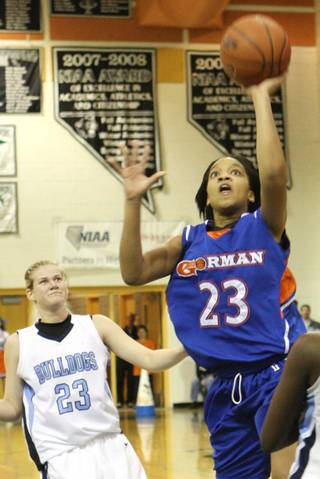 Bishop Gorman guard Yahindra Edwards goes for the basket against Centennial during the girls Sunset Regional championship game at Palo Verde High School on Friday.