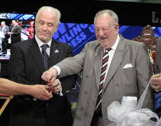 Las Vegas Mayor Oscar Goodman (right) and USBC Chief Operating Officer Kevin Dornberger cut the ribbon to open the USBC Open Championships at Cashman Center.