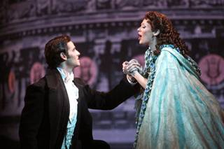 On the rooftop, Andrew Ragone as Raoul and Kristi Holden as Christine during