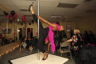 Nichet Gray, 19, practices leg kicks on the striptease pole during the Stiletto Fitness class on
