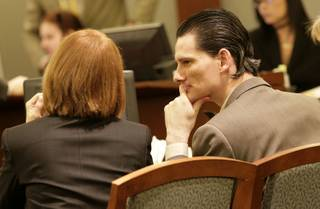 Chester A. Stiles confers with his attorney, public defender Stacey Roundtree, as testimony continues in his trial. Stiles faces 22 charges in connection with the sexual assaults of two young girls. Jurors heard opening arguments and testimony from one of his alleged victims and her mother on Monday.