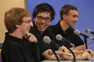 Palo Verde seniors, from left, Thomas Cole, Kian Ameli and Taylor Krabial react with laughter as the judges announced their team won the Varsity Quiz championship Monday afternoon at Vegas PBS studios. Palo Verde was victorious over Green Valley 165 to 125.