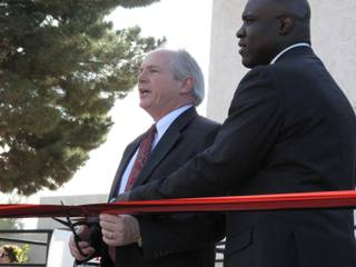 UNLV President David Ashley and Harrah's Entertainment vice president of national diversity relations Tony Gladney cut the ribbon outside the newly dedicated Multicultural Center-Centro Multicultural at UNLV's campus Wednesday.