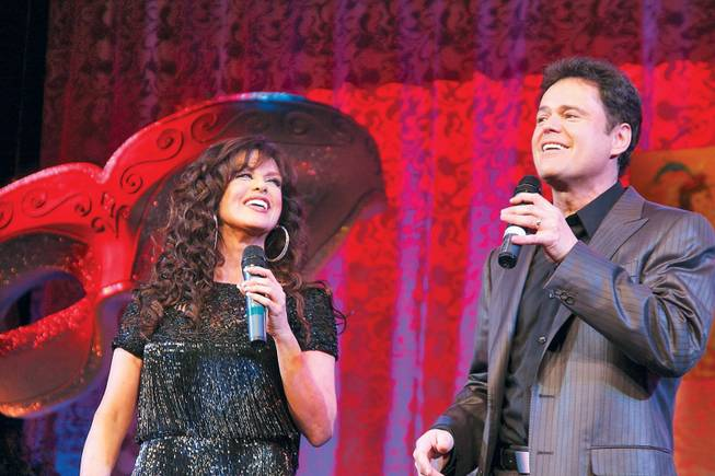 Marie Osmond and Donny Osmond perform at the Children's Miracle Network Mardi Gras Ball in the Bellagio Ballroom in February 2009.