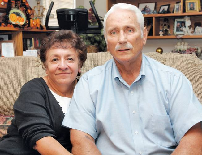 Former Basic and Green Valley football coach Lanny Littlefield, who has been diagnosed with non-alcoholic cirrhosis of the liver, and his wife, Gloria, stand in their home in Henderson on Oct. 5, 2006.