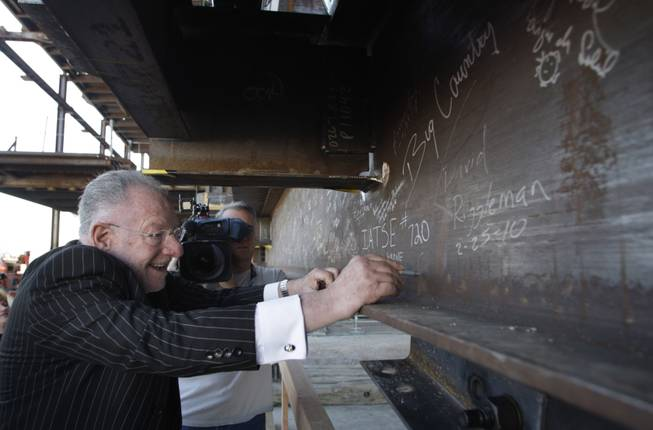 Mayor Oscar Goodman signs a beam during a topping-off ceremony for the Smith Center for the Performing Arts in downtown Las Vegas on Thursday, Feb. 25, 2010.