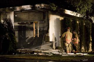 City of Las Vegas firefighters wrap up extinguishing a fire that followed an explosion at a home at 2601 Mason Ave. Fire officials said arson might be to blame in the incident. Neighbors reported the blaze at about 8:30 p.m. Thursday.
