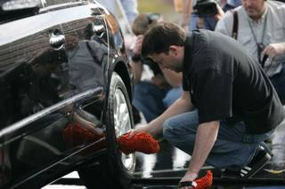 Two-time NASCAR Cup champion Tony Stewart volunteered his time washing cars at Coronado High School to help raise money for the school's racing program Thursday.