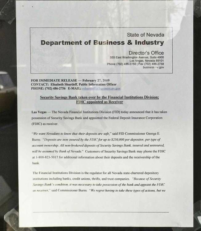 A notice posted on the door of Security Savings Bank, which was taken over by the Nevada Financial Institutions Division on Friday. The Federal Deposit Insurance Corp. is the receiver.