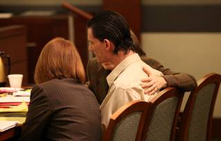 Defense attorneys Amy Coffee, right, and Stacey Roundtree quiet Chester A. Stiles after an outburst Friday. He became visibly upset for the first time since his trial started when excerpts from letters he wrote to former girlfriend Susan Windrem were read aloud.