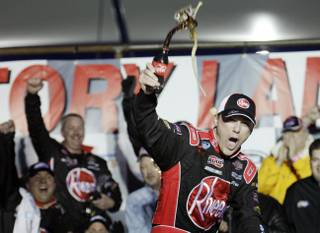 Kevin Harvick celebrates after winning the NASCAR Nationwide Series Sam's Town 300 auto race at the Las Vegas Motor Speedway on Saturday, Feb. 27, 2010.