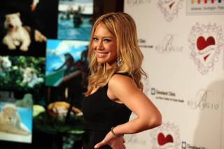 Actress Hilary Duff poses on the red carpet on the way into the 13th Annual Power of Love Gala at the Bellagio in Las Vegas on Feb. 28.