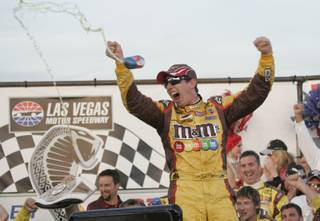 Kyle Busch celebrates winning the Shelby 427 NASCAR Sprint Cup Series race on Sunday.