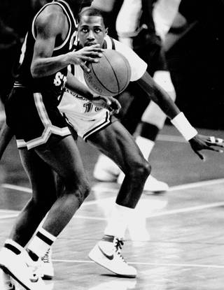 Runnin' Rebels Freddie Banks stares down a player on defense. Banks is one of four Runnin' Rebels to score over 2,000 points in a career.