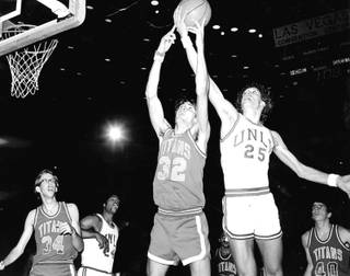 Glen Gondrezick fights for a rebound. Gondo, a key member of the Hardway Eight, was a gritty player who played a number of roles for the Rebels.