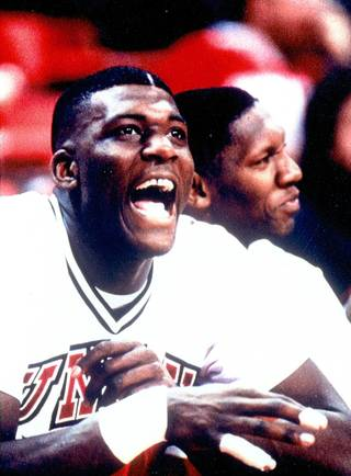UNLV great Larry Johnson cheers on his teammates from the Rebels bench. Johnson led the Rebels to a NCAA title and another Final Four appearance.