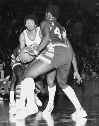 UNLV's Reggie Theus tries to drive to the basket for the Rebels.